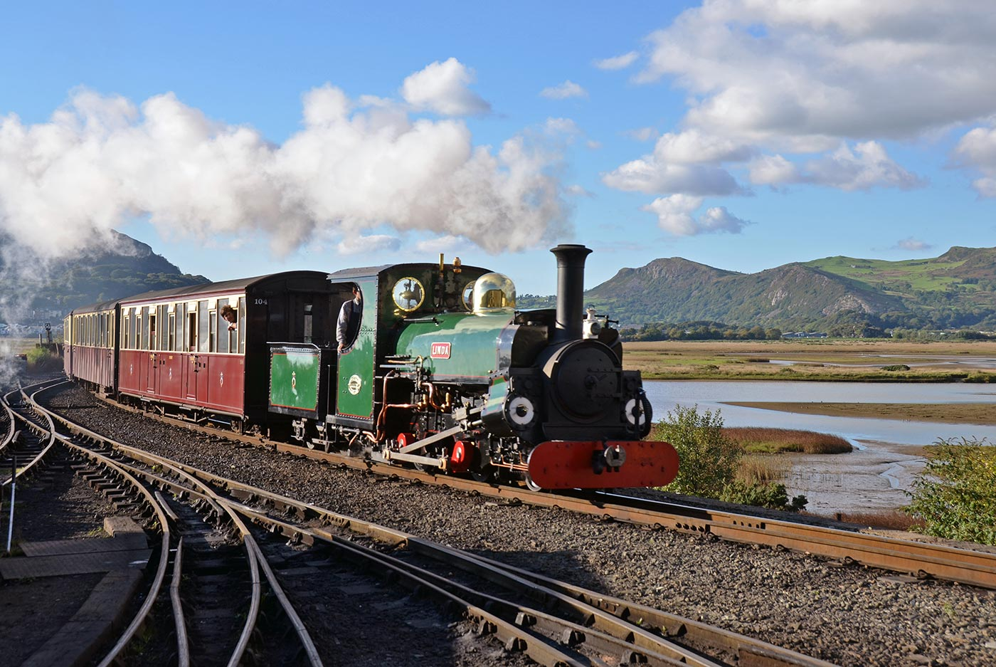 Scenic steam train travelling along Ffestiniog Railway