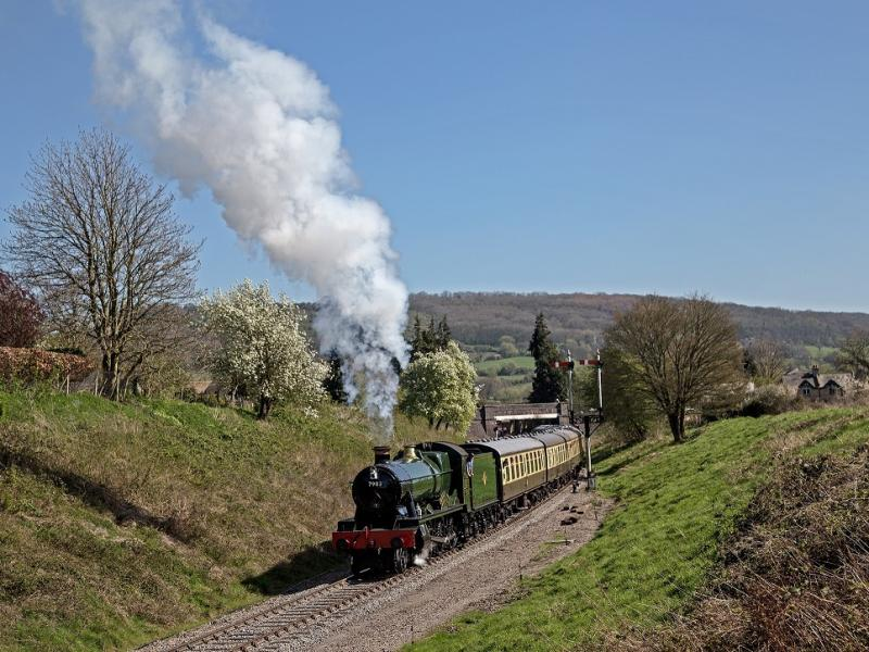 Hall class 7903 Foremarke Steam train pulling away from Winchcombe station with a Cheltenham-bound service along the Gloucestershire Warwickshire Railway