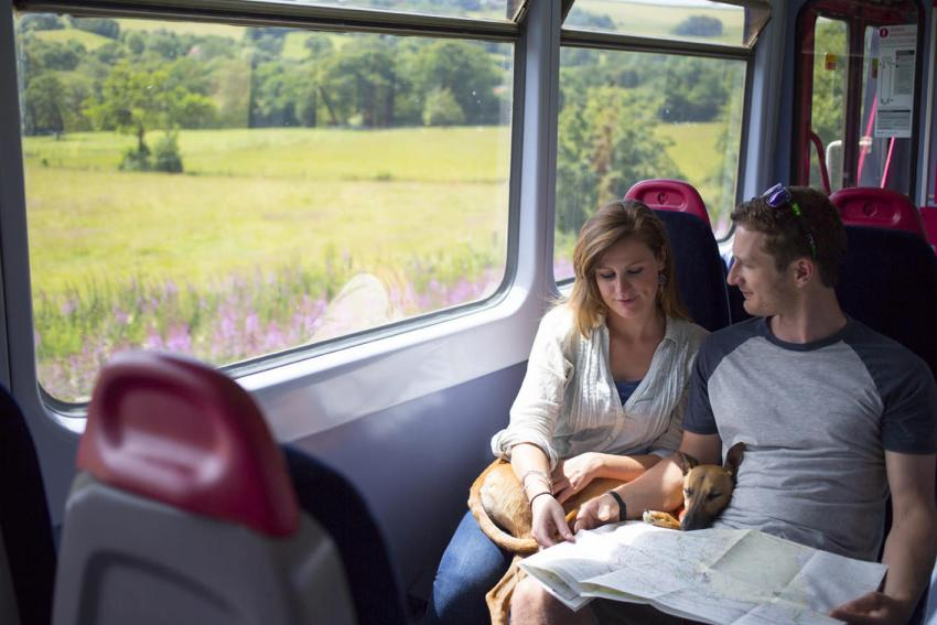 A couple travelling on the Tarka Line in Devon