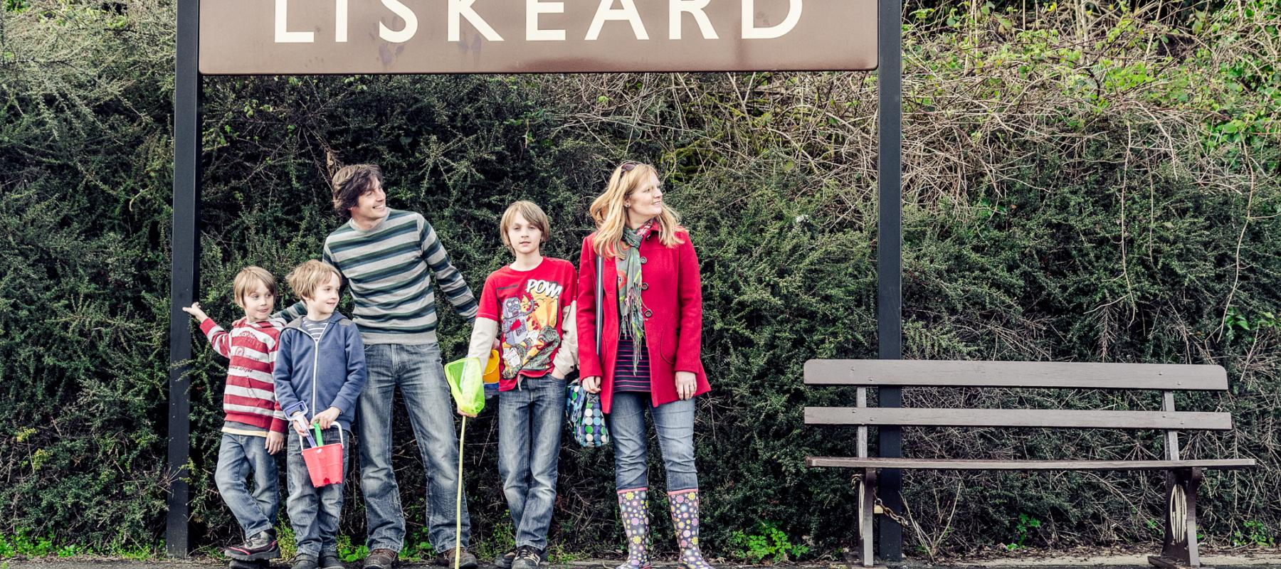 Family waiting for the train at Liskeard station
