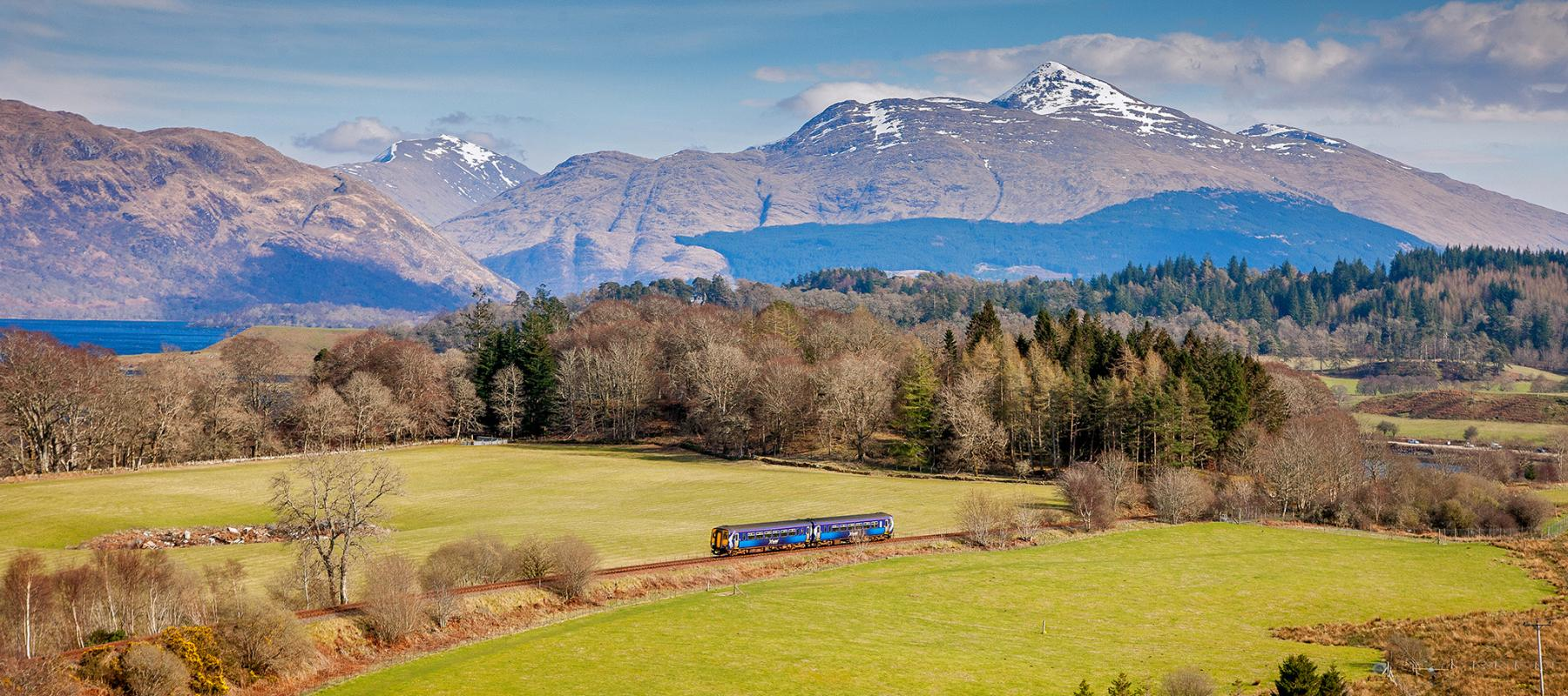 Train on the The West Highland Line with mountains in the background