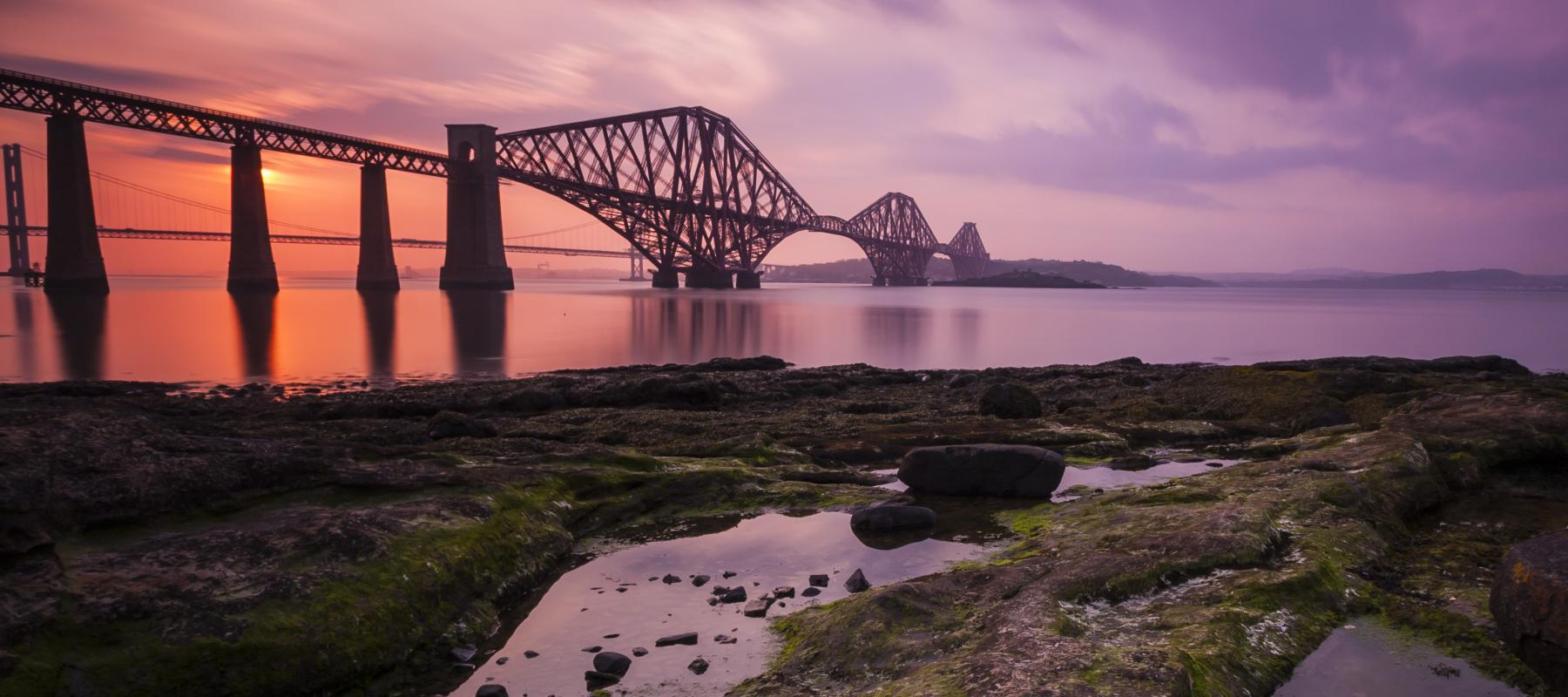 Travel along the historic Forth Bridge.