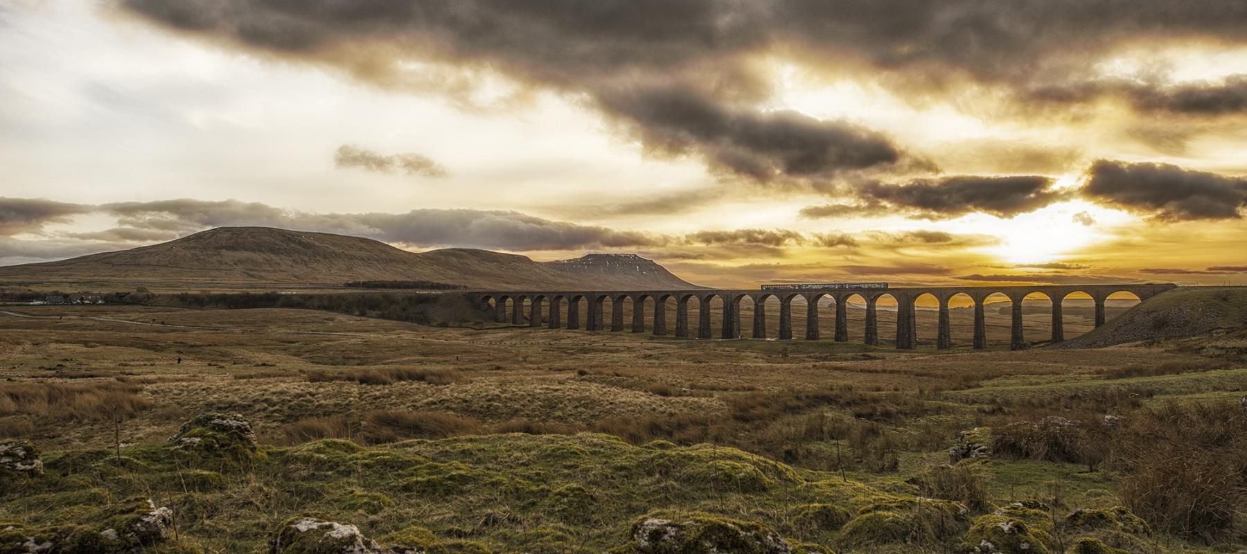 Train on the Settle-Carlisle line with dramatic sunset in the background