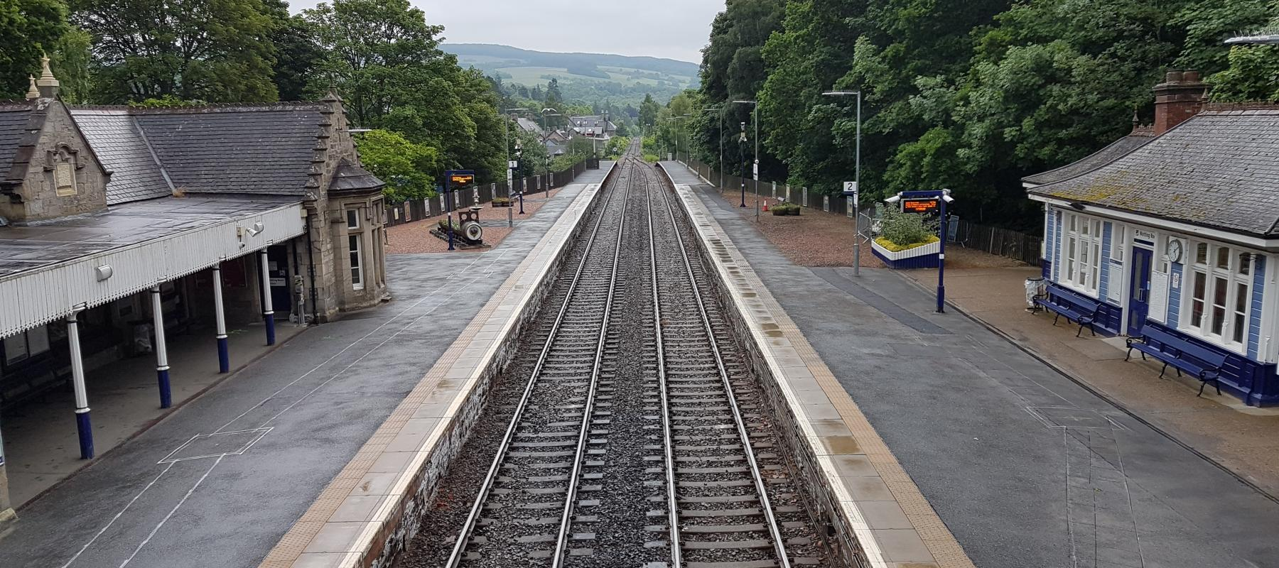 ScotRail Train travelling on the Horseshoe Viaduct along the Highland Line, Scotland