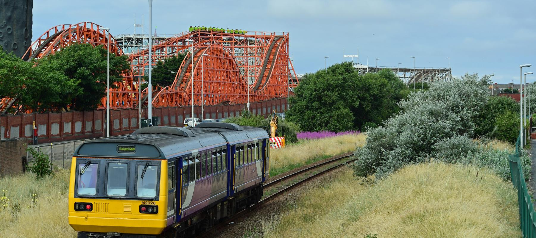 Train in front of Blackpool Pleasure Beach, South Fylde Line