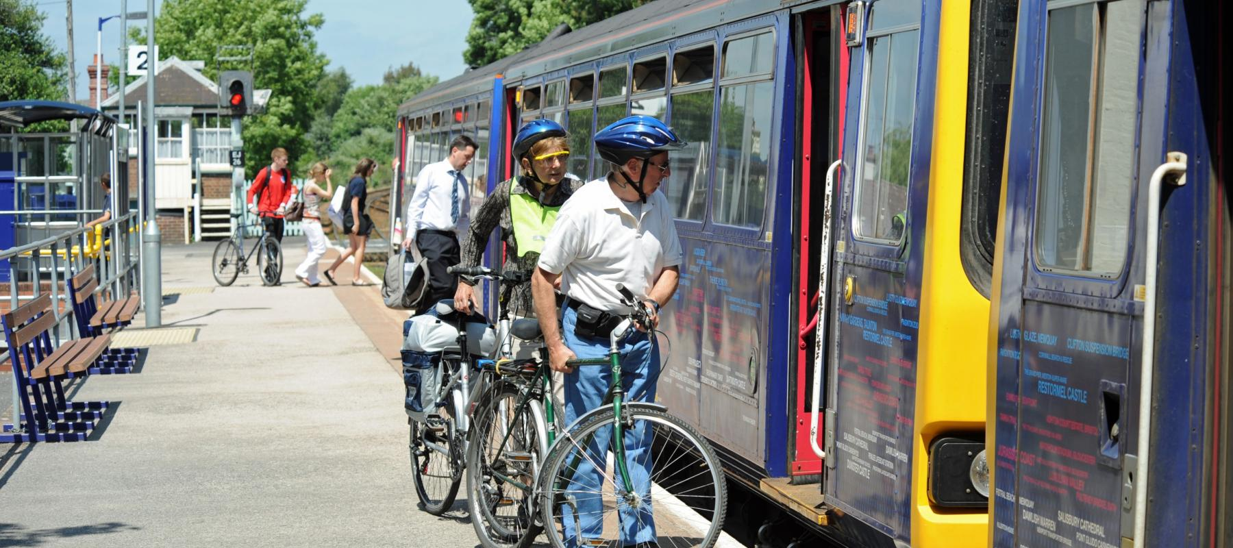Cyclists boarding train at Topsham Station, on the Avocet Line