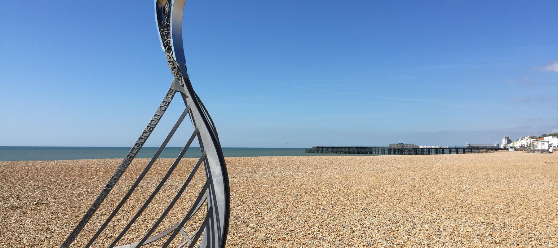 Hastings beach in the sunshine, along the Marshlink Line