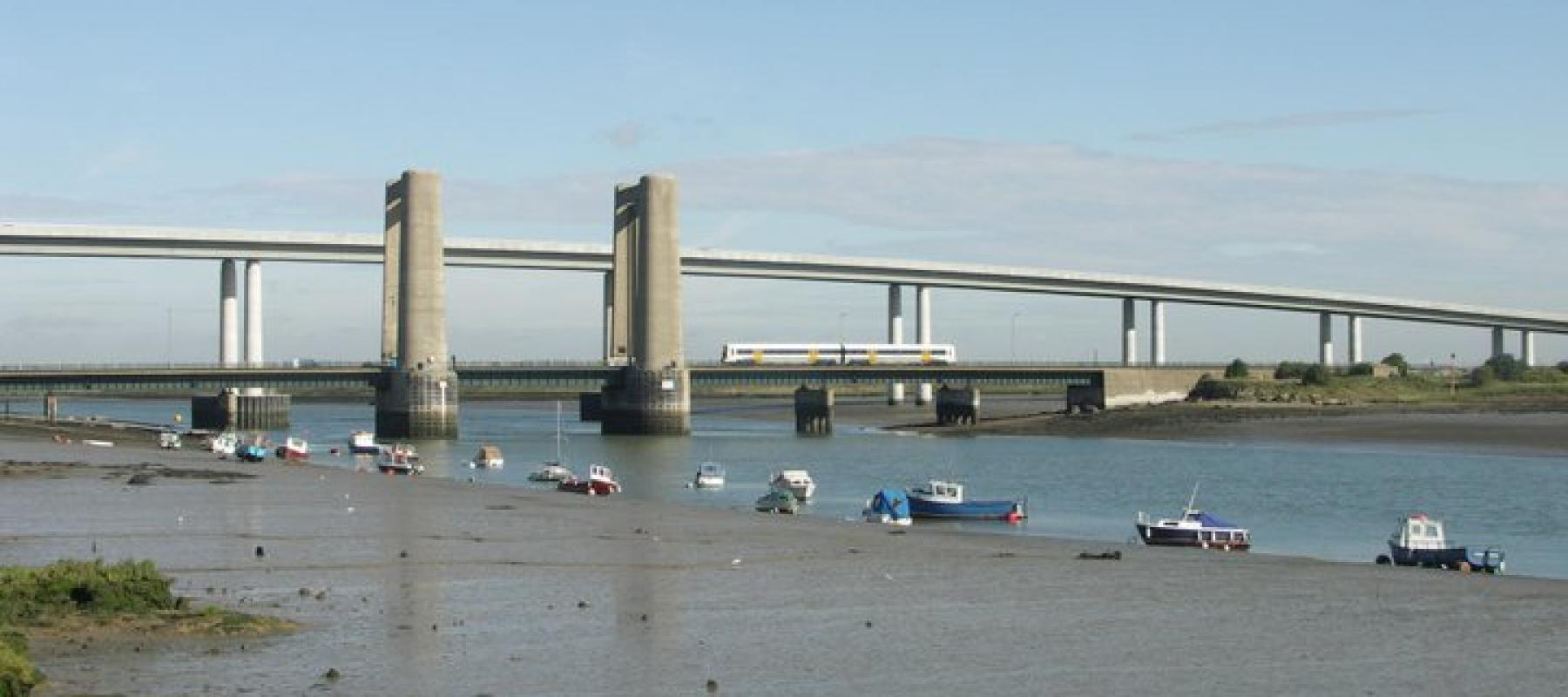 Train travelling along the Kingsferry Bridge and Sheppey Crossing along the Swale Rail line. South East UK.