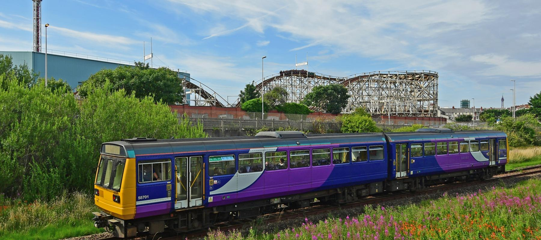 Train travelling along the South Fylde Line and passing Blackpool Pleasure Beach