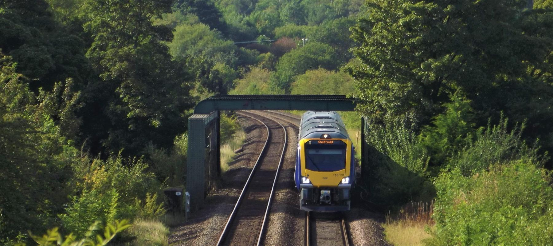 Train travelling through the stunning landscape of the Hope Valley Line