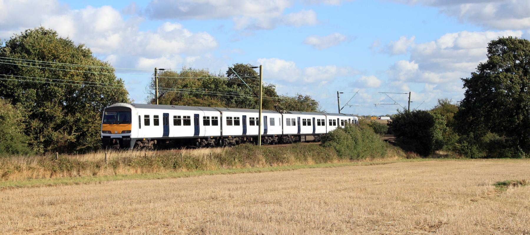 Train travelling along the Sunshine Coast line. East UK.