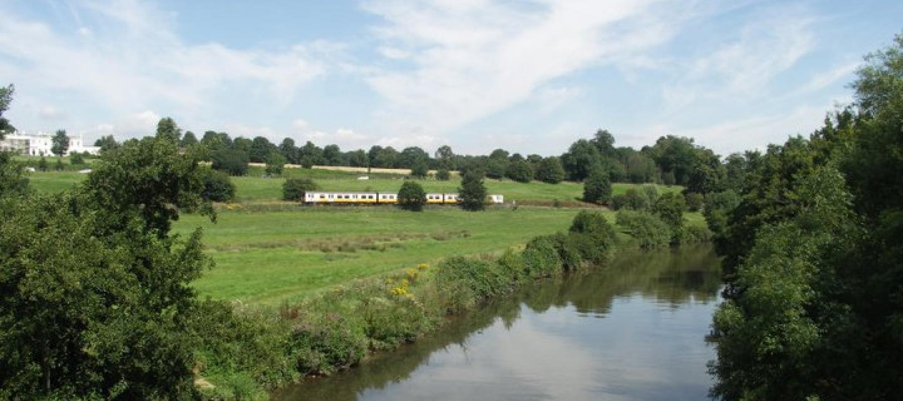 Train travelling through the countryside along the Medway Valley railway line. South East UK.