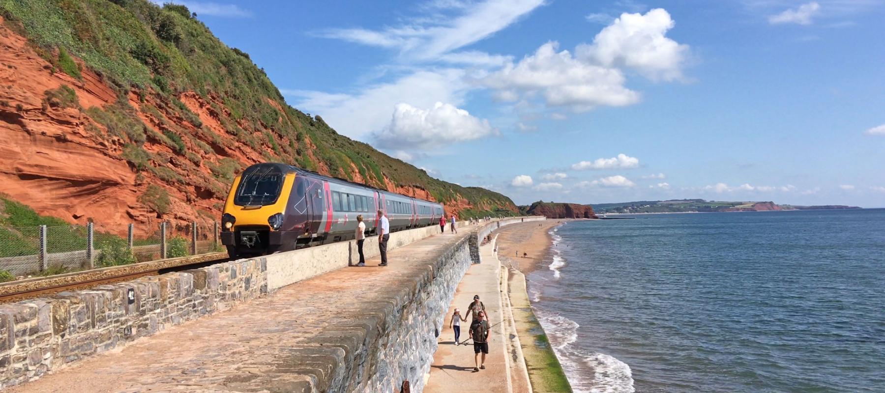 CrossCountry train on the sea wall approaching Dawlish station