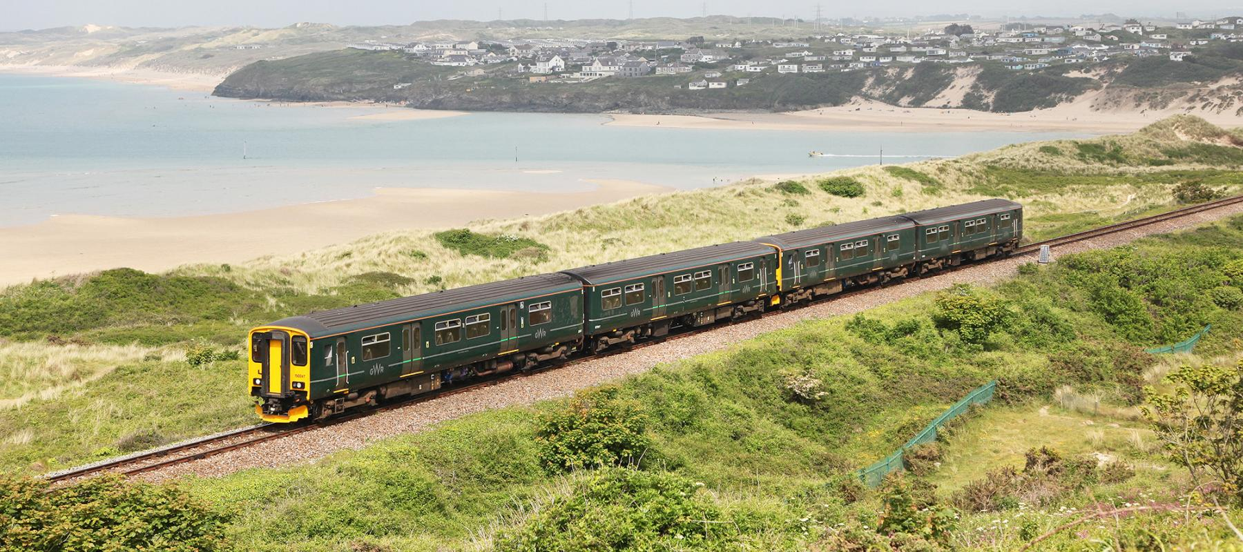Train on the St Ives Bay Line with the beach and sea in the background