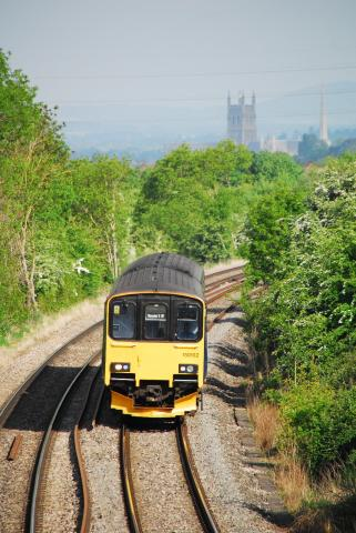 Train heading into Worcester with Cathedral spire in background