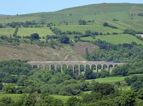 A train travels along the Heart of Wales railway