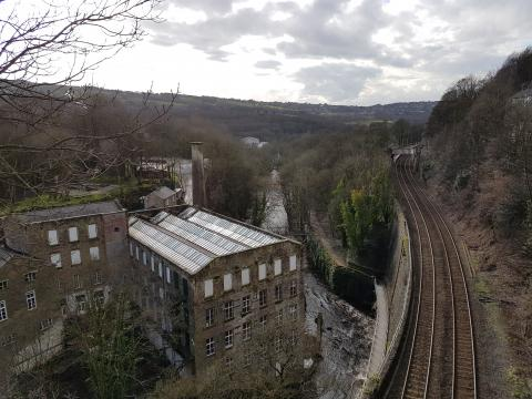A view overlooking mills and the railway near New Mills