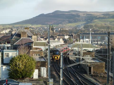 Skipton Railway Station with picturesque countryside in the background.