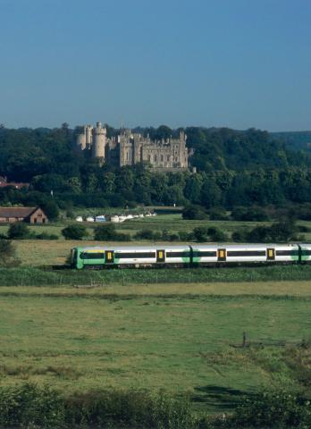 Arundel Castle with a train travelling along the Arun Valley Line