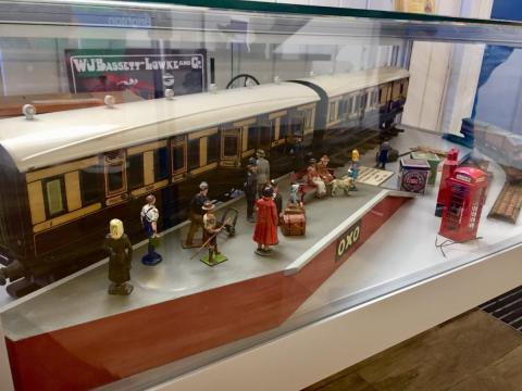 A toy model of an old train at a station on display Brighton Toy Museum