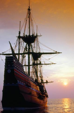 Mayflower ship on the sea at sunset