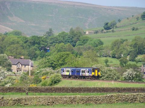 Northern train travelling through Edale along the Hope Valley Line