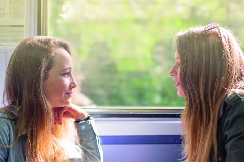 Pair of rail passengers