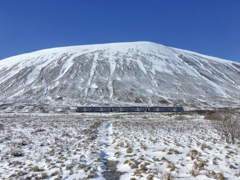 Train travelling through the Drumochter Pass