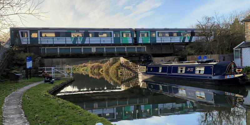 Train crossing the Grand Union Canal along the Marston Vale Line