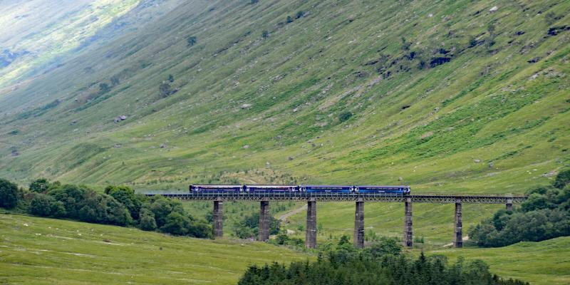 ScotRail Train travelling on the Horseshoe Viaduct along the Highland Line, Scotland