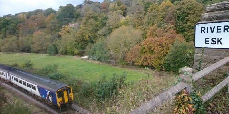 A view of the Esk Valley Line near the River Esk