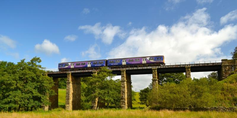 Train crossing Clapham Viaduct along the Bentham Line. Yorkshire & North East UK