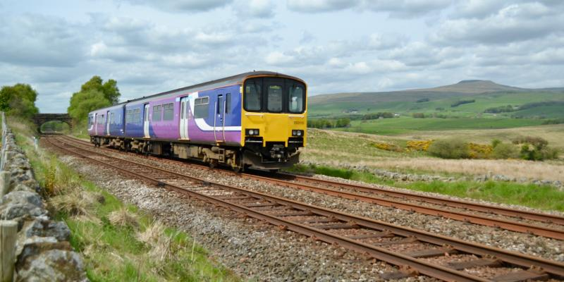Bentham Line train travelling through the countryside