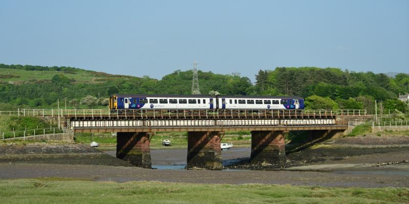 Northern train travelling along the Cumbrian Coast at Ravenglass