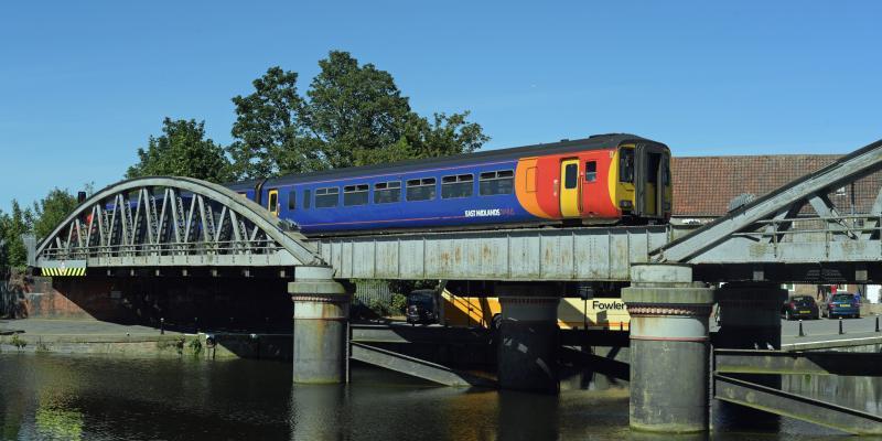 Train crossing a river along the Poacher Line