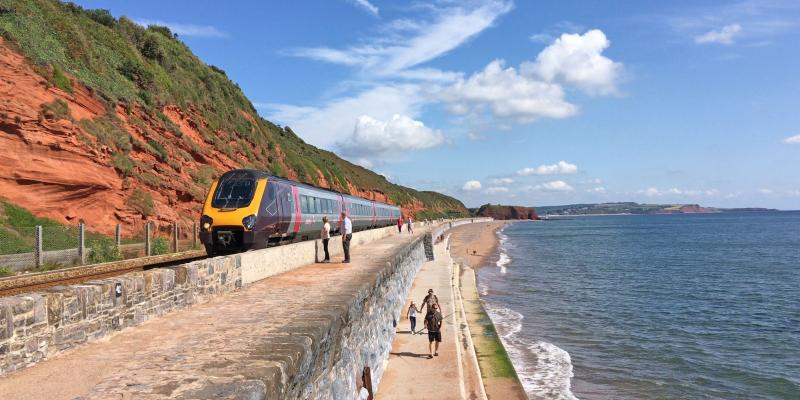 CrossCountry train on the sea wall approaching Dawlish station