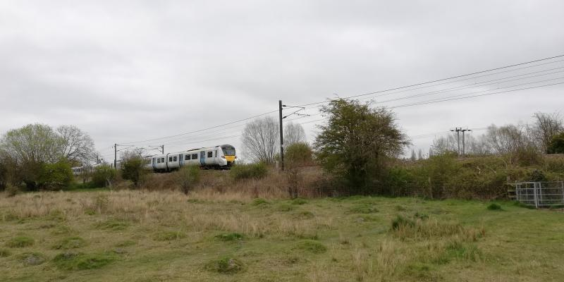Train travelling through the English countryside