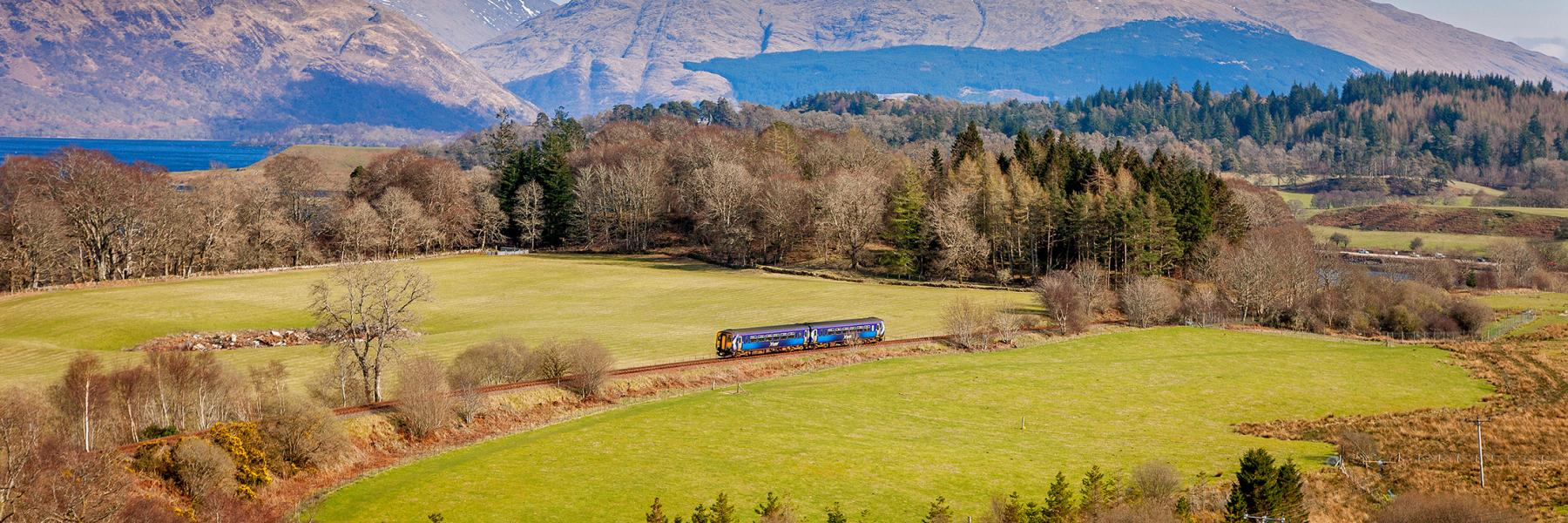 Train on the West Highland Line with mountains in the background