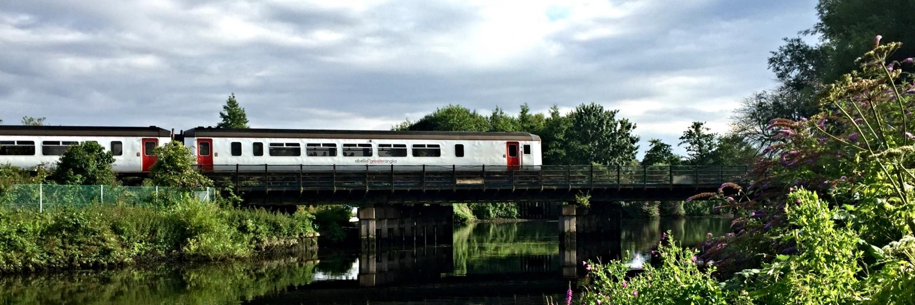 Train crossing the New Cut near Norwich along the Wherry Lines.