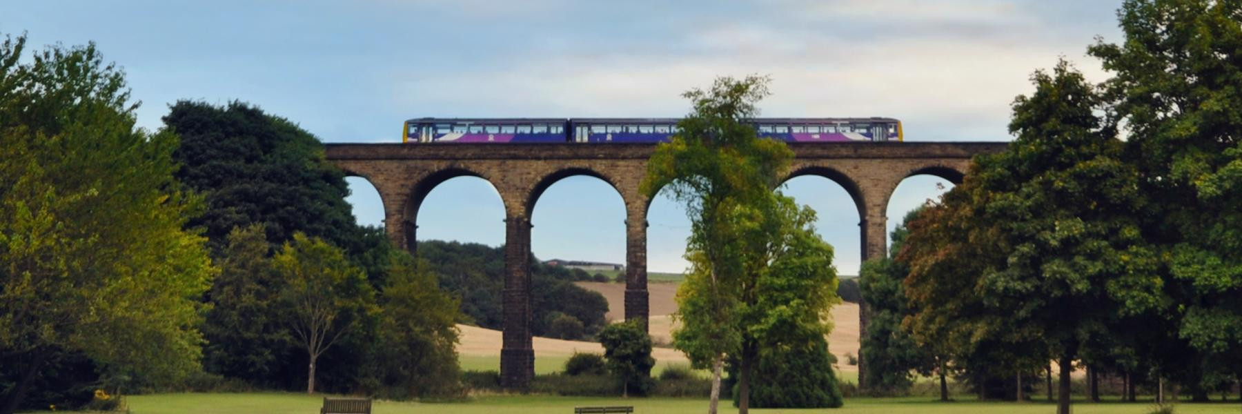 Train crosses viaduct along the Penistone Line